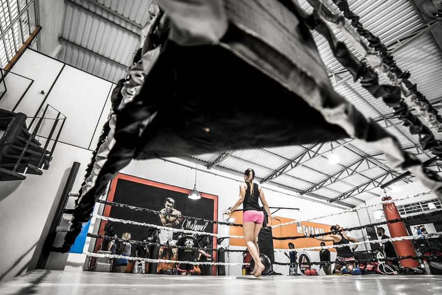 Woman doing workout inside the boxing ring